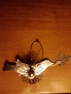 Peace Dove Ornament - Handmade silver foil paper ornament with rare vintage embellishment and pressed leaf.  (Limited quantity available) $25