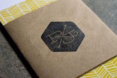 Create a logo stamp to use on event invites and cards. Black or white ink looks great on brown paper.