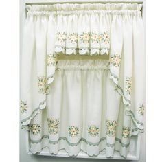 Would you like to incorporate a romantic country look into your kitchen decor? The gracefully simple Floral Medallion Cream Ruffled Kitchen Curtain will add a sense of country chic to any window they cover. Crafted of clean Cream polyester fabric and highlighted with a delightful flower accents, the window coverings also feature a distinctive sage colored border. The two tiered design with scalloped edges adds further to the beauty and charm of the coverings. These curtains provide enough…