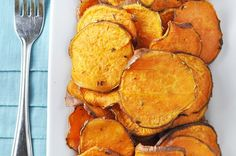 Sliced up sweet potato with rosemary, thyme and garlic powder, tossed in oil and baked