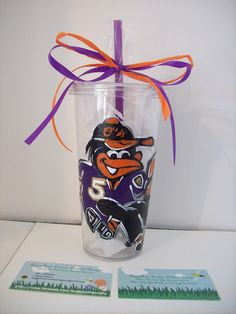 Oriole Bird wearing a Ravens jersey on a hard plastic drinking tumbler(with purple straw(other color straws available))...now you can take your favorite BuggyBean Custom Painted Designs with you! http://www.facebook.com/buggybeandesigns