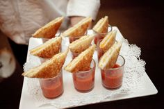 Mini grilled cheese sandwiches with shot glasses of tomato soup. Great appetizer for fall entertaining!