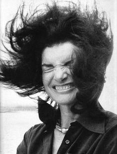 Jacqueline Kennedy onboard the Staten Island Ferry. Wind blown. Still classy!