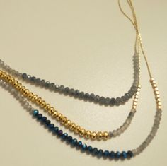 Triple Strung Color Bead and Chain Necklace Navy, gun metal, gold.  2 of the three strands are color beaded and the third middle strand is cut plastic gold beads.  The necklace is finished with a beautiful  petit gold chain. AshBmarie Jewelry Necklaces