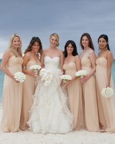 oscar de la renta bridal gown and coral amsale bridesmaids gowns -- all strike the right chord between formal and beachy.