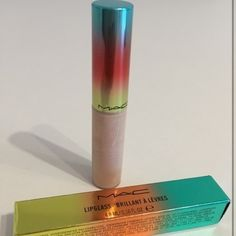 "NIB MAC Wash & Dry Lipglass L. Ed. ""Girl on Board"" Gorgeous creamy color that looks amazing over a nude lipstick. This product is brand new it looks like gloss may have settled a bit but it has never been opened or used. MAC Cosmetics Makeup Lip Balm & Gloss"