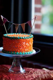 Adorable turquoise and orange cake! @Emma Wernecke