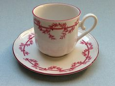This is a sweet tea cup and saucer made in Germany by Seltmann Weiden Bavaria. The cup and saucer have a decoration of pink colored leaves. The rims are also pink. The set is in very good condition. There is a very little dip in the glazing on top of the handle. Please be