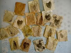 Reused tea bag art. I think I'd empty the tea bags and fill them with lavender or some scented herbs.