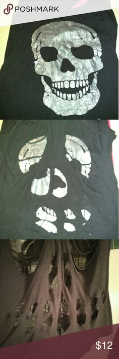 Women's skull tank top with designer holes in back Women's 💀 tank top with designer holes in the back, you can wear it over a bathing suit or with shorts, jeans, skirt. My daughter bought this in Tarpon Springs on spring break last year. The top is black with a silver skull 💀 on the front and Tarpon Springs written in silver at the very bottom.As you can see in the pics the back is cut up in different places (design of the top) size small popular sports Tops Tank Tops