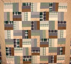 Memory quilt made from men's shirts and pants. sarahduffeyquilts.com