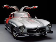 silver on red leather Mercedes Benz, classic 300SL,