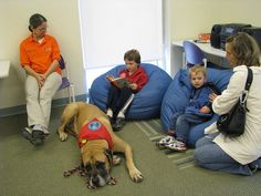 Practicing reading skills:    Ohio snapshot day: Children practicing their reading skills with a therapy dog as part of the Tales for Tails program. Rodman PUblic Library
