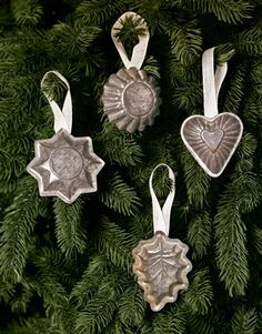 Vintage baking molds add a sweet touch to any tree; simply hot-glue ribbon loops to their backs and hang.   - CountryLiving.com