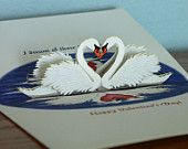 http://www.etsy.com/listing/89975784/3d-popup-swans-valentine-card-reflect-on