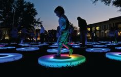 """501 LIFE The Conway Alliance for the Arts recently hosted the 7th annual Conway ArtsFest, a festival of music, art, theatre, dance, creative writing & film. Festivities included a sculpture by light & sound artist Jen Lewin, presented by the UCA Baum Gallery of Fine Art. """"The Pool"""" was an interactive light installation made up of 106 circular platforms. As visitors interacted with """"The Pool,"""" light changed according to their movements, creating a unique experience for each."""