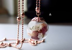 This delicate floral orb. | 19 Tiny Pieces Of Botanical Jewellery You�ll Fall In Love With
