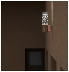 Wall LED lamp made of stainless steel and hand blown glass.