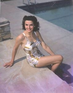 411ecabe46d11 Actor Jane Russell sits by the side of a swimming pool