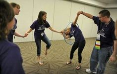 Students race to pass a hula hoop around each other while holding hands as they play cooperative games while participating in the Building Leaders And Strong Tomorrows Youth Group Games, Team Games, Youth Activities, Team Building Activities, Activity Games, Family Games, Fun Games, Games For Kids, Party Games