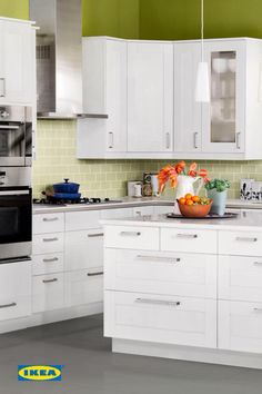 IKEA kitchen cabinets #deltafaucetinspired. Love the white and apple green color