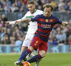 Barca's attacking midfielder Ivan Rakitic (right) shields the ball from Rochina during Saturday's game