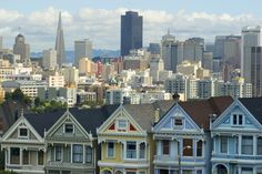 Free Stock Photo: colourful houses at alamo square with the san francisco city skyline on the back ground - not property released - By freeimageslive contributor: photoeverywhere