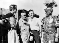 While vacationing in Rome, Kirk Douglas visits Charlton Heston, director William Wyler and Jack Hawkins on the set of BEN-HUR   1959