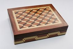 Marquetry by MARTINS... this box was made with Brasilian woods: Mahogany(red), Imbuia(brown) and wood Ivory(white). [made in São Paulo-BRASIL]
