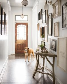 Inspired by her grandmother's gallery wall, a mix of family photos and drawings fills the entryway hallway.
