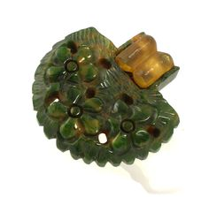 Bakelite Army Green Marbled Carved Dress Clip // 1930s to 1940s // Apple Juice Accent by RefinedRetro on Etsy https://www.etsy.com/listing/192173119/bakelite-army-green-marbled-carved-dress