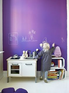 Painted wall for kids to draw on. Cool.