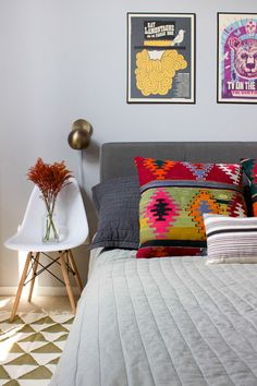 Patterned pillows, colorful wall art, and modern decor combine to create a space that's full of personality in this fun home tour.
