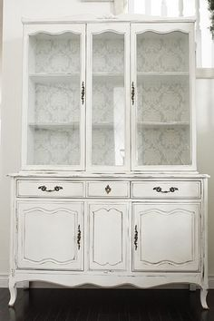 white refinished dining room hutch (back of shelving color too