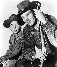 Mark McCain (Johnny Crawford) Lucas McCain (Chuck Connors) Marshall Micah Torrance (Paul Fix, not pictured) The Rifleman was a 30 minute family western action series on ABC. I was about a widower who raised his son to be a decent and caring, but strong man in the old West. His one desire was to successfully homestead his ranch in North Fork, New Mexico.