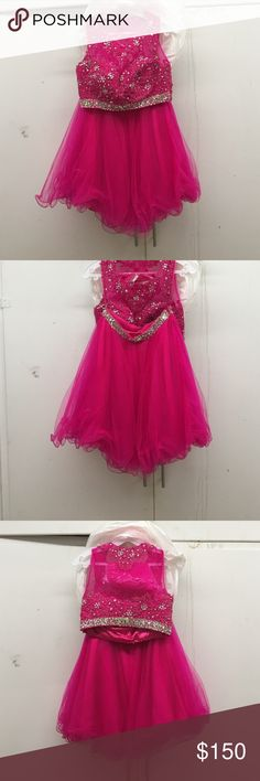 Hot pink two piece prom dress Hot pink two piece prom dress. Top is sleeveless with gemstones accenting a lace floral pattern. Sheer tule on top. Many layers of tule on bottom. Gemstones accent the waist. Extra tule from purchase still in packaging. Zipper on the side. Let's Dresses Prom