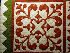 Quilt with Vibrant Design in Red and Green
