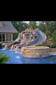 amazing waterfall and water slide for outdoor pool. Wish I could put this in our pool Dream Pools, Pool Houses, Big Houses With Pools, Pool Designs, Backyard Designs, Dream Garden, Garden Tub, Garden Paths, My Dream Home