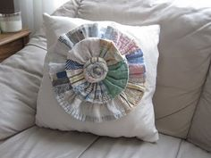 My latest pillow made from a tattered quilt found at Goodwill.