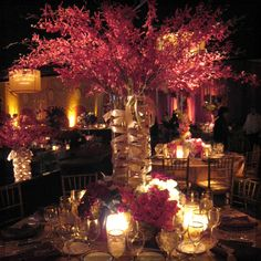 Luxurious floral centerpiece and table scape.-Love the height of the center piece