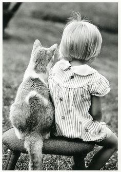 Girl and a cat card.  photographer?