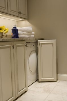 really cool laundry room with hideaway appliances
