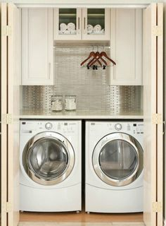 I am obsessed with laundry room ideas right now.... I love! this backsplash.