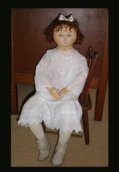 Cloth Drawn-face doll in antique baby clothes and shoes
