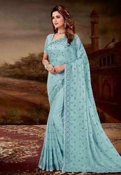 A premium collection of indian designer sarees. Order this faux chiffon and faux crepe firozi classic saree for bridal and wedding. Latest Indian Saree, Indian Sarees Online, Indian Beauty Saree, Buy Designer Sarees Online, Indian Designer Sarees, Crepe Saree, Tussar Silk Saree, Wedding Sarees Online, Saree Wedding
