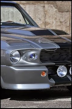 """1967 Ford Mustang """"Eleanor""""  (drove the Hollywood blockbuster """"Gone in 60 seconds"""" from 2000, starring Nicolas Cage and Angelina Jolie) - Said Eleanor Mustang VIN # 7R02C173895 was built by Cinema Vehicle Services & comes with all the signature performance & style elements, including the distinctive two-tone silver & charcoal color & the go-baby-go-shifter, along with a letter of authenticity. Eleanor has a Ford Racing 351 cubic inch (5.8-liter) V8."""