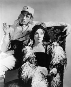 """Gary Cooper and Marlene Dietrich in director Josef Von Sternberg's """"Morocco"""".  Would Von Sternberg himself have chosen to use that relatively flat lighting employed in this posed still...?"""