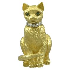 Tiffany & Co. Emerald Diamond Gold Cat Pin | From a unique collection of vintage brooches at https://www.1stdibs.com/jewelry/brooches/brooches/