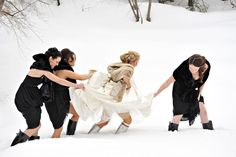 Love this photo. True friends will help you trek through the snow in your winter wedding dress.