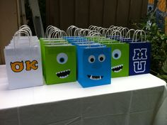 Monsters Inc. / Monsters University Favor Bags I made these for my son's 3rd birthday party. I purchased the plain colorful bags from Five Below.  I made templates for the Greek letters, college letter, Sulley's nose, and Mike and Sulley's mouths. I used circle punches for the eyes.
